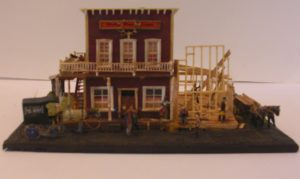 Dirty Fox Saloon is built using a Campbell kit with a scratch built new construction addition. The wagons are Jordan kits. Some of the figures are not longer available. By Gary Whistleman.