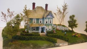 Old Money is built from a very complicated and intricate Laser Art kit. Notice the complex ginderbread trim. The main gable has stained glass added. By Gary Whistleman